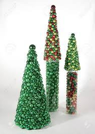 three trees made of multicolored ornaments sit on a