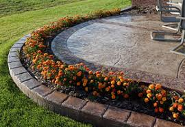 stamped concrete patio with flower bed patio pinterest