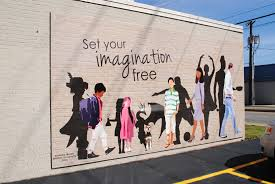 murals shop merchant street shop merchant street this mural is ground level and faces south on 480 east main street it was painted and designed by lindsey quick it encourages people to read books and let