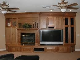 circle entertainment center using varnished walnut wood tv cabinet