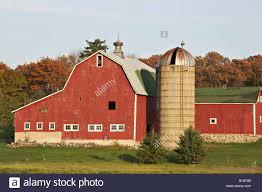 wisconsin kenosha county red barn with white trim stone foundation