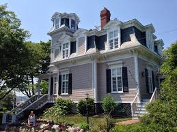 exterior beautiful mansard roof and dormer with exterior paint