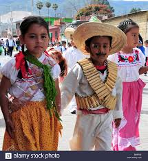 mexican children in national costume parading on anniversary of