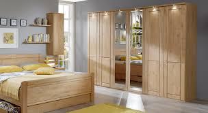 Schlafzimmer Schrank Natur Schlafzimmerschrank Mit Drehtüren Und Spiegel Aus Erle Trikomo