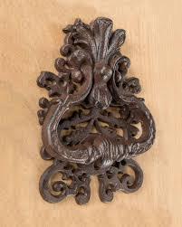 backyards brown decorative door knocker with ornate design cast