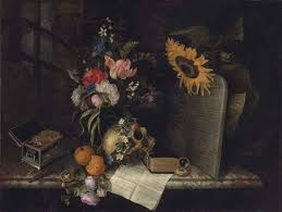 roses tulips irises and other flowers in a vase a skull with a