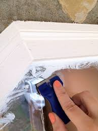 how to remove paint from windows