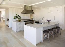 Coastal Kitchen And Bar - coastal kitchen features a white center island topped with bianco