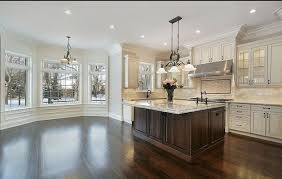 white kitchen cabinets with black island enchanting antique white kitchen cabinets with island and