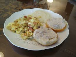 sausage gravy and biscuits grits and eggs hash browns and ham