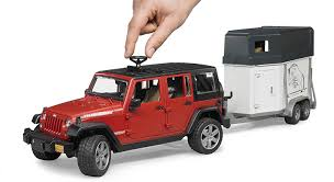 jeep wrangler unlimited amazon com bruder jeep wrangler unlimited rubicon with horse