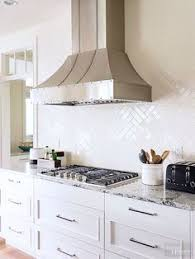 kitchen backsplash white matte glass herringbone tiles make for a beautiful backsplash