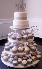 wedding cake and cupcake ideas pink and purple wedding cake with a cupcake towers at brookshire
