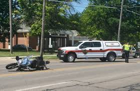 man injured when motorcycle and pickup truck collide late thursday