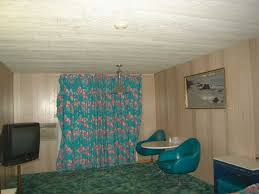 curtains and dinette suite in my room at the royal hawaiian motel