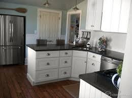 white kitchen cabinets with black quartz black quartz countertop houzz