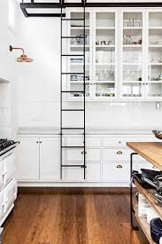 112 best decorate it kitchen images on pinterest white kitchen with rolling ladder for easy access to tall cabinets