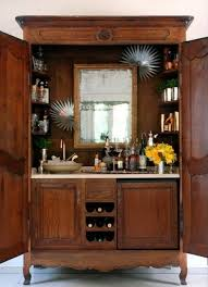 vintage piece of furniture turned into a bar sink and all b