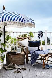 Patio Umbrella Table And Chairs by Best 25 Beach Style Outdoor Umbrellas Ideas On Pinterest Beach