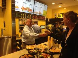 buffalo wild wings thanksgiving buffalo wild wings is giving away free wings at its new express
