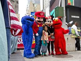 cookie monster and elmo halloween costumes times square cartoon actors arrested