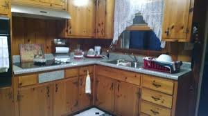 painting knotty pine kitchen cabinets white how can i do a makeover with knotty pine cabinets and walls
