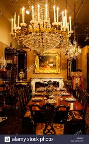a colonial house dining room with chandelier and art work on