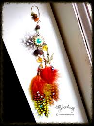 one side feather earring willow studio new one side fly away earring