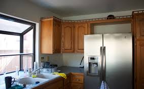 how to sand and stain kitchen cabinets answer how can i refinish my kitchen cabinets without