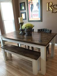 solid wood farmhouse kitchen table with matching wooden bench