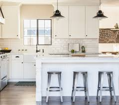 distressed gray floors farmhouse sink white cabinets white