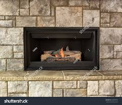 burning natural gas fireplace surround by stock photo 502968796