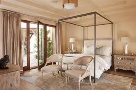 traditional master bedroom with pendant light doors in