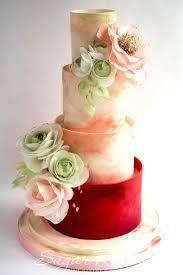 watercolor themed wedding cake adorned with wafer paper flowers