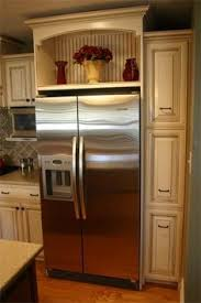 wine rack cabinet over refrigerator black and white kitchen makeover reveal wine rack anna and wine