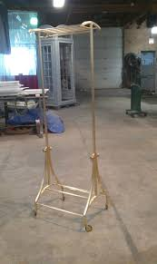 hand made custom brass and bronze rolling clothing rack by hulse