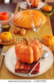 thanksgiving dinner table setting pumpkins wheat stock photo