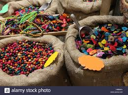jute bags filled with trinkets and decorations buttons and