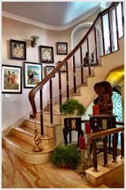 94 best home make over images on pinterest puja room indian lining the walls of the stairway are ravi varma lithographs and tanjore paintings that create a indian home decorindia