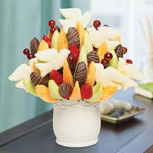 edible deliveries peace doves bouquet swizzle berries apples edible arrangements