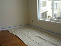 how to protect your floors during a painting project protecting