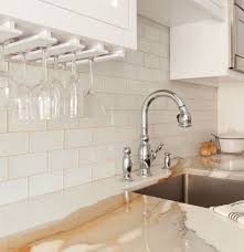 antique white kitchen cabinets with subway tile backsplash cozy manhattan apartment combines vintage flare with modern