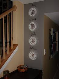 simple decor for a narrow wall space clocks with baby photos