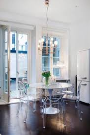 Ghost Dining Chair A Clear Beaded Chandelier By Overstock Illuminates A White Ikea