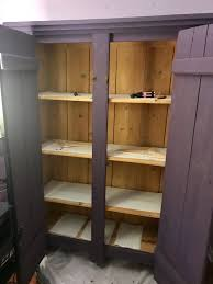 refinished this vintage narnia wardrobe in purple chalk paint with