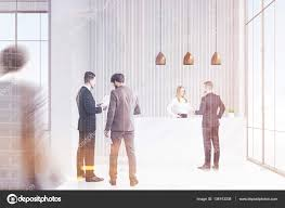 Standing Reception Desk by People In Business Suits Are In An Office Hallway Pair Of Them Is