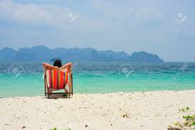 Chairs On A Beach A Man Sitting On Beach Chair Looking At Sea Stock Photo Picture