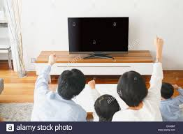 Tv In Living Room Young Japanese Family Watching Tv In The Living Room Stock Photo