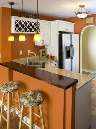 decorating with warm rich colors orange walls white cabinets
