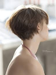 view of a short haircut that barely covers the ears